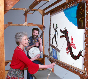 Jack runs from the Dragon - Deb Chase, shadow puppeteer / Mick Doherty, musician - Photo by Leo Arfer